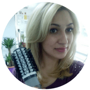 woman styling hair with a hot air brush